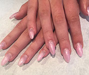 A client enjoying one of our nail treatments.